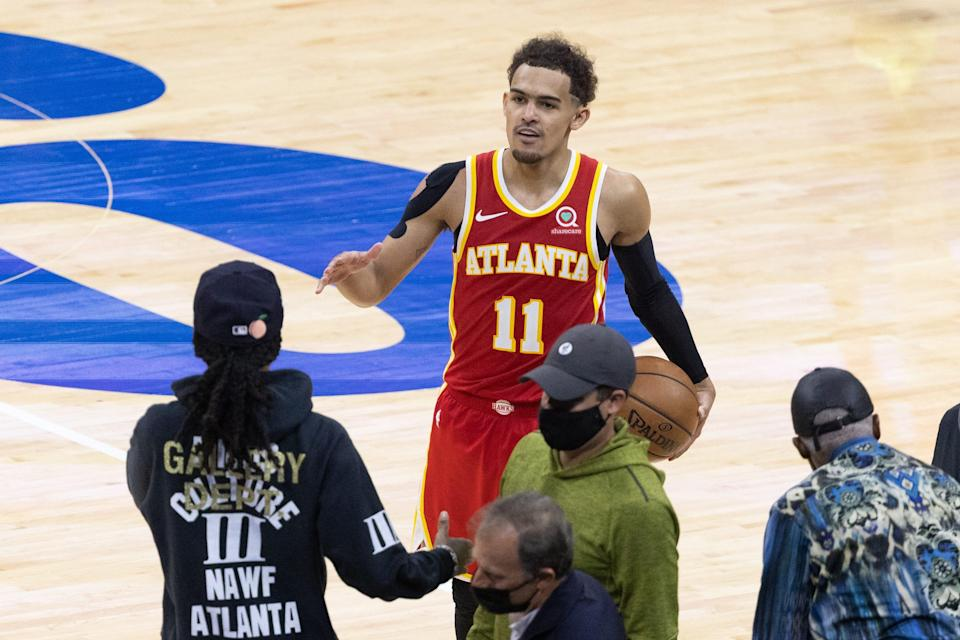 Trae Young celebrates with fans after the Atlanta Hawks' Game 5 win against the Philadelphia 76ers.