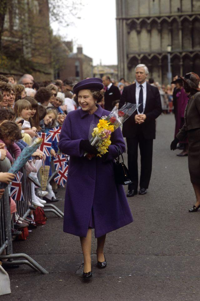 <p>Queen Elizabeth II meets wellwishers outside Ely Cathedral after presenting Maundy money to pensioners. (PA Archive) </p>