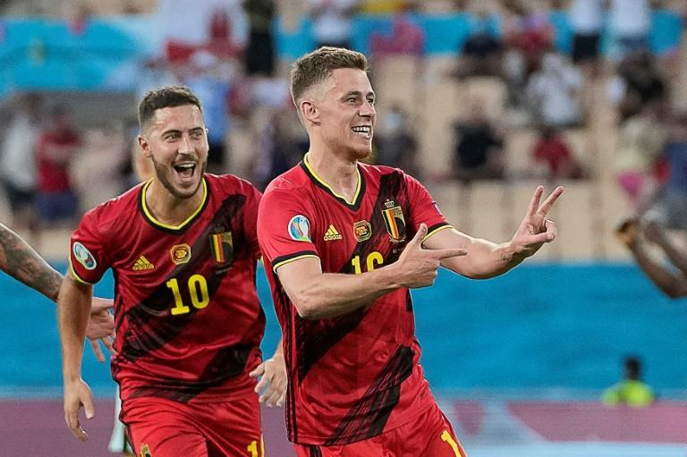 Thorgan Hazard (R) celebrates with his brother Eden after scoring Belgium's goal against Portugal in Seville
