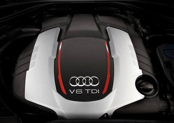 The top of an engine, showing Audi's four-rings logo and