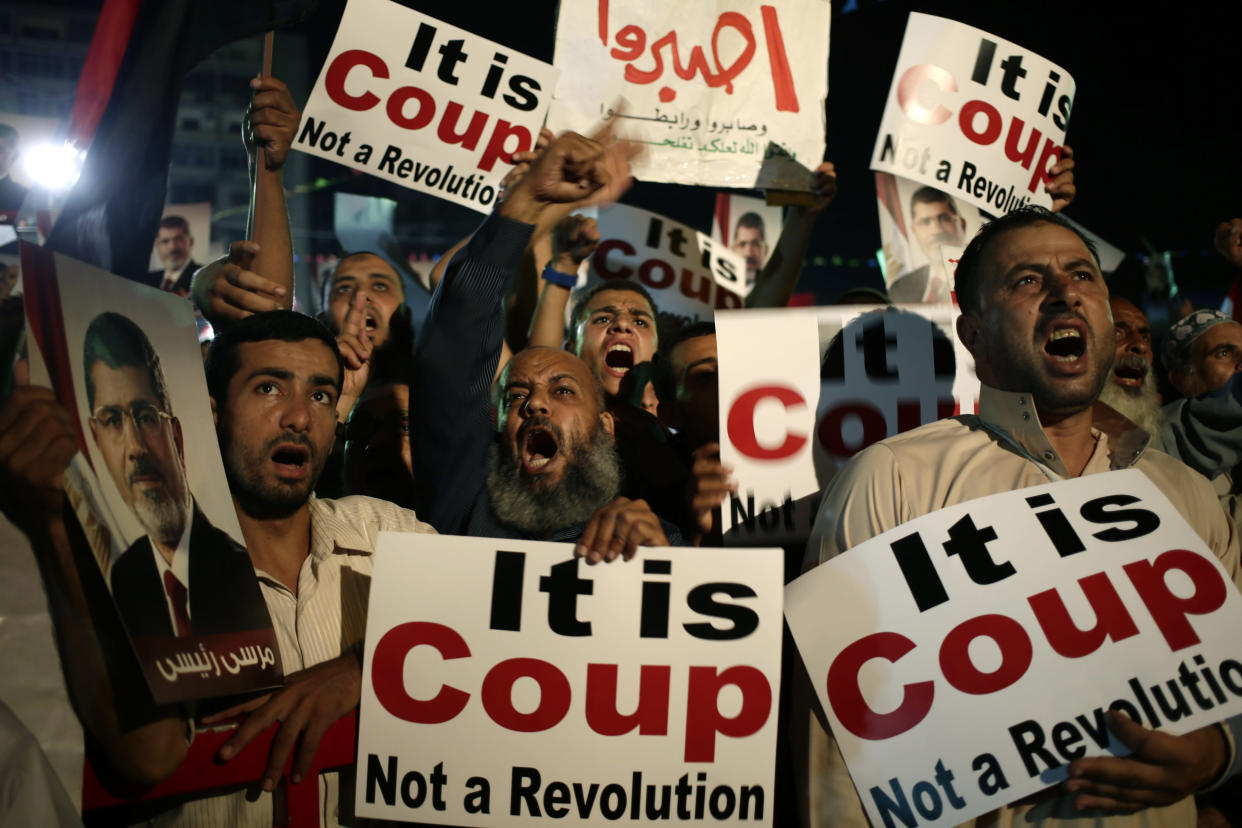 Supporters of Egypt's ousted President Mohammed Morsi chant slogans against Egyptian Defense Minister Gen. Abdel-Fattah el-Sissi at Nasr City, where protesters have installed a camp and hold daily rallies, in Cairo on July 28, 2013. (Hassan Ammar/AP)