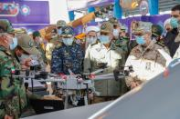 Iranian Armed Forces Chief of Staff Major General Mohammad Bagheri and other top commanders visit Iranian-made military drones as they are unveiled in an exhibition in Semnan