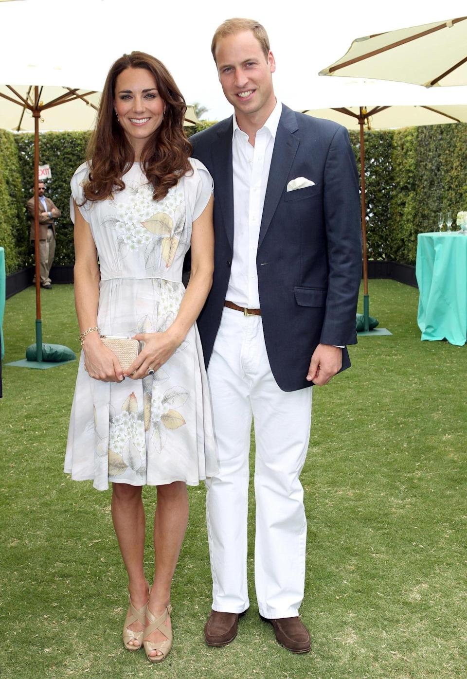 <p>The Duchess wore a handpainted silk dress by Jenny Packham for a polo match in Santa Barbara. L.K. Bennett sandals and a matching bag topped off her outfit. </p><p><i>[Photo: PA]</i></p>