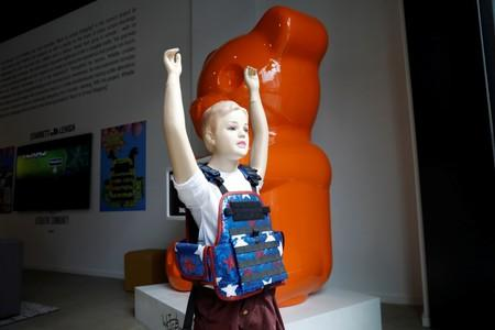 """A child mannequin is seen wearing a bullet proof vest as part of an art installation by artist WhIsBe titled """"Back to School Shopping"""" to illustrate the dangers of gun violence in schools, at a gallery in New York City"""