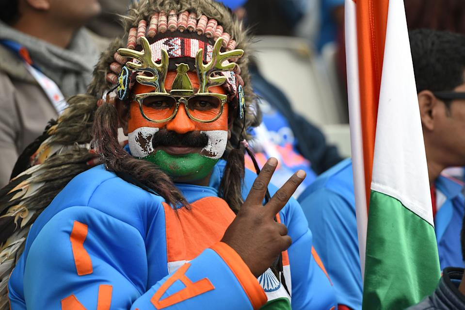 A very colourful Indian fan (Photo by OLI SCARFF/AFP/Getty Images)