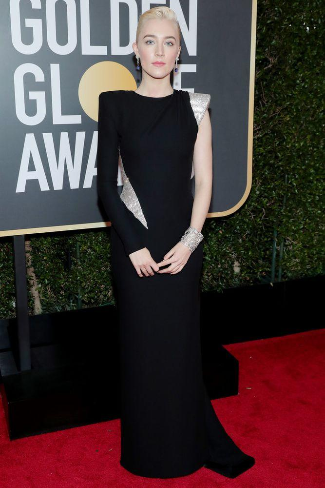 <p>in Atelier Versace gown, Cartier jewels, and <a data-ecommerce=