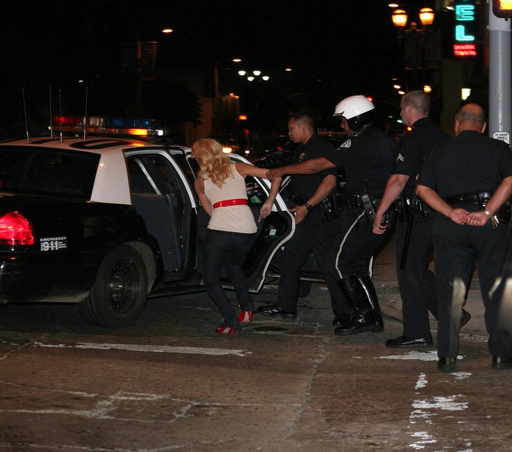 "Paris Hilton is arrested. That's hot! RCRSJ/<a href=""http://www.x17online.com"" target=""new"">X17 Online</a> - September 7, 2006"
