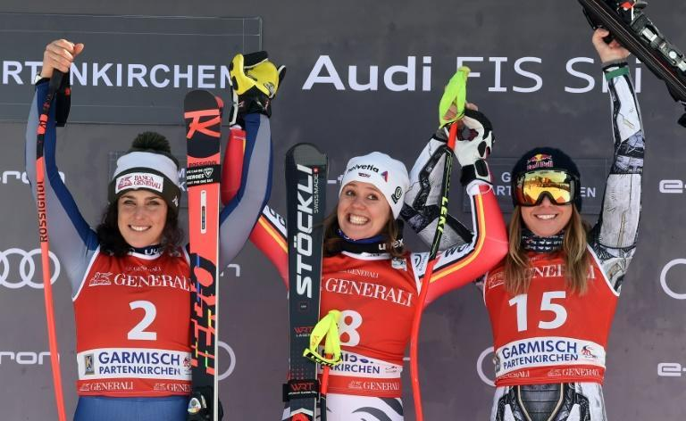 Germany's Viktoria Rebensburg (C) celebrates with Federica Brignone of Italy (L) and third-placed Czech Ester Ledecka (R) after winning the women's downhill on Saturday in Garmisch-Partenkirchen. (AFP Photo/Christof STACHE)