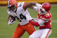 Cleveland Browns running back Nick Chubb (24) is tackled by Kansas City Chiefs safety Tyrann Mathieu (32) during the second half of an NFL divisional round football game, Sunday, Jan. 17, 2021, in Kansas City. (AP Photo/Charlie Riedel)