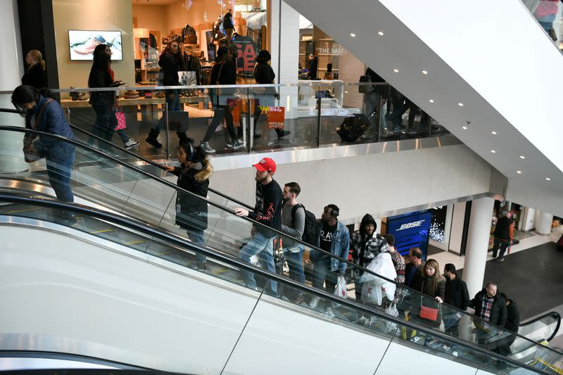 FILE PHOTO: Holiday shoppers look for deals at the Pentagon City Mall in Arlington