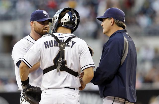 San Diego Padres starter Sean O'Sullivan, left, gets a visit from pitching coach Darren Balsley, right, and catcher Nick Hundley during a first inning jam against the Cincinnati Reds in a baseball game in San Diego, Monday, July 29, 2013. (AP Photo/Lenny Ignelzi)
