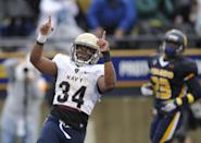 Navy fullback Noah Copeland (34) celebrates his touchdown run in the second quarter of an NCAA college football game against Toledo in Toledo, Ohio, Saturday, Oct. 19, 2013. (AP Photo/David Richard)