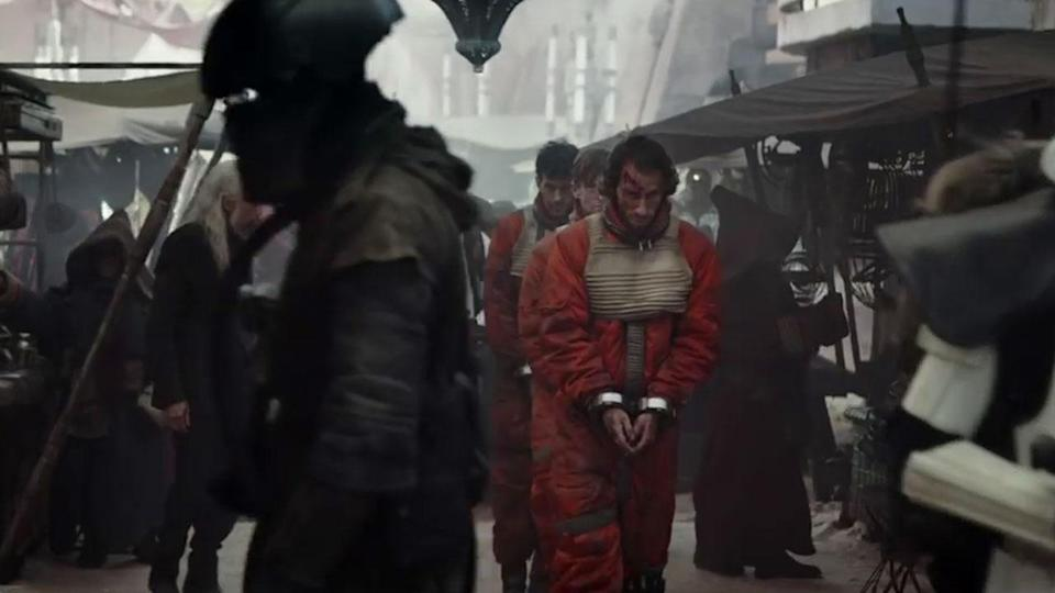 <p>This shot of Rebel pilots being marched through Jedha also ended up on the cutting room floor. Credit: Lucasfilm/Disney </p>