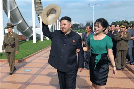 North Korean leader Kim Jong-Un and his wife Ri Sol-Ju attend the opening ceremony of the Rungna People's Pleasure Ground on Rungna Islet along the Taedong River in Pyongyang in this July 25, 2012 file photograph released by the North's KCNA to Reuters on July 26, 2012. REUTERS/KCNA/Files