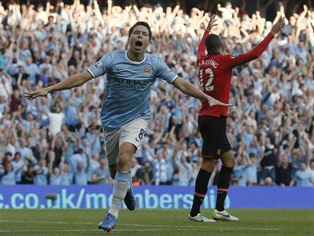 Manchester City's Samir Nasri celebrates scoring against Manchester United during their English Premier League soccer match at the Etihad Stadium in Manchester, northern England, September 22, 2013. REUTERS/Phil Noble