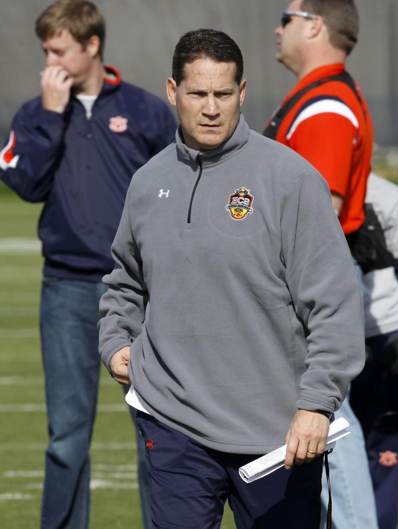 Auburn's Gene Chizik paces around during NCAA college football practice Wednesday, Jan. 5, 2011, in Scottsdale, Ariz.  Auburn is scheduled to play Oregon in the BCS Championship on Monday, Jan. 10, in Glendale, Ariz. (AP Photo/Ross D. Franklin)