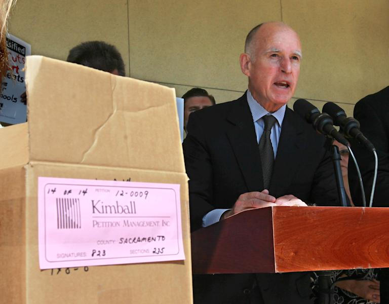 Gov. Jerry Brown discusses his tax-hike initiative before submitting the petitions for the initiative to the Sacramento County Registrar of Voters in Sacramento, Calif., Thursday, May 10, 2012. Brown's initiative is one of two tax hike petitions that are expected to qualify for November ballot. Brown has warned that if voters do not pass the tax hikes there would be even deeper cuts to schools, higher education and social services. (AP Photo/Rich Pedroncelli)