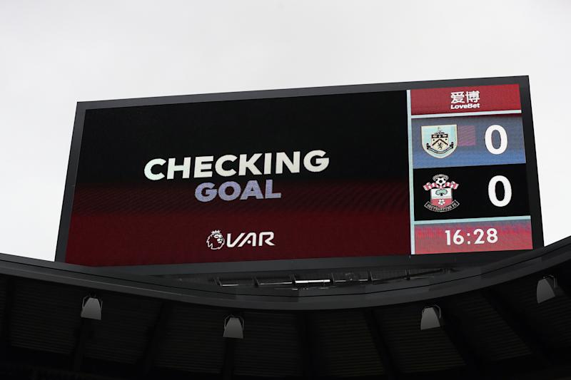 VAR decision is made for Burnley's Chris Wood's goal during the Premier League match at Turf Moor, Burnley. (Photo by Martin Rickett/PA Images via Getty Images)