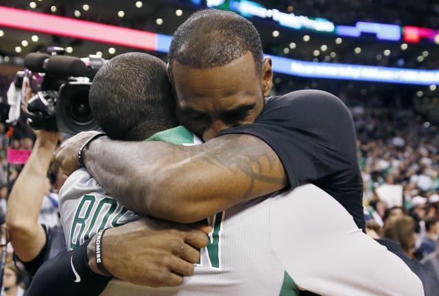 The Cleveland Cavaliers' LeBron James, right, hugs the Boston Celtics' Kyrie Irving following their game in Boston on Feb. 11. (Photo: AP/Michael Dwyer)