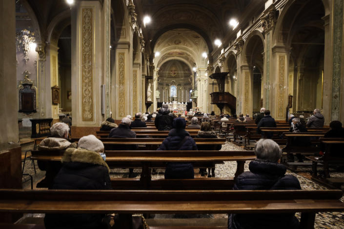People attend a Mass in Codogno, northern Italy, Sunday, Feb. 21, 2021. The first case of locally spread COVID-19 in Europe was found in the small town of Codogno, Italy one year ago on February 21st, 2020. The next day the area became a red zone, locked down and cutoff from the rest of Italy with soldiers standing at roadblocks keeping anyone from entering of leaving. (AP Photo/Luca Bruno)