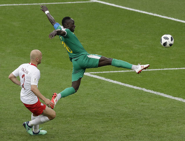 Senegal's Sadio Mane, right, and Poland's Michal Pazdan challenge for the ball during the group H match between Poland and Senegal at the 2018 soccer World Cup in the Spartak Stadium in Moscow, Russia, Tuesday, June 19, 2018. (AP Photo/Themba Hadebe)