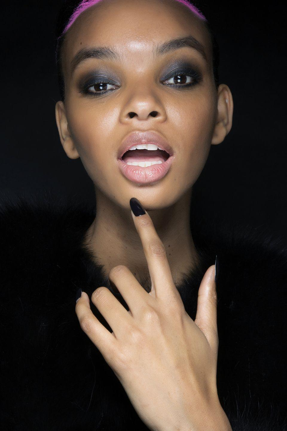 """<p>Nothing makes a statement like an all-black manicure. Done in high gloss or matte, a black manicure is chic and sophisticated with a little edge. Here, a model backstage at Philipp Plein with almond-shaped black nails.</p><p>Essie nail polish in Licorice, $8.99, <a href=""""https://www.target.com/p/essie-nail-polish-0-46-fl-oz/-/A-53827187?preselect=13249434#lnk=sametab"""" rel=""""nofollow noopener"""" target=""""_blank"""" data-ylk=""""slk:target.com"""" class=""""link rapid-noclick-resp"""">target.com</a>. <a class=""""link rapid-noclick-resp"""" href=""""https://www.target.com/p/essie-nail-polish-0-46-fl-oz/-/A-53827187?preselect=13249434#lnk=sametab"""" rel=""""nofollow noopener"""" target=""""_blank"""" data-ylk=""""slk:SHOP"""">SHOP</a></p>"""