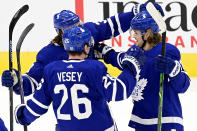 Toronto Maple Leafs defenseman Justin Holl (3) and teammates Jimmy Vesey (26) and Zach Hyman (11) celebrate a goal during the first period of an NHL hockey game against the Montreal Canadiens Wednesday, Jan. 13, 2021 in Toronto. (Frank Gunn/The Canadian Press via AP)