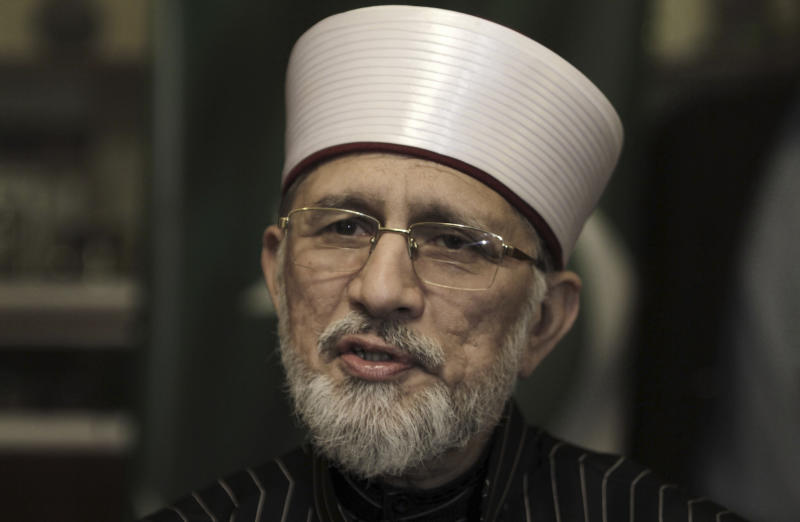 In this Wednesday, Jan. 9, 2013, photo, Pakistani cleric Tahir-ul-Qadri, speaks during an interview with The Associated Press, in Lahore, Pakistan. To his supporters Muslim cleric Tahir-ul-Qadri is the savior of Pakistani politics recently returned from abroad to right the country ahead of upcoming elections. To his detractors, he is a shady religious figure bent on derailing the vote, possibly at the behest of the country's powerful military. (AP Photo/K.M. Chaudary)