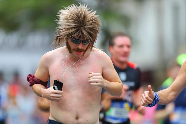 <p>A runner sports a interesting hairstyle during the 2017 New York City Marathon, Nov. 5, 2017. (Photo: Gordon Donovan/Yahoo News) </p>