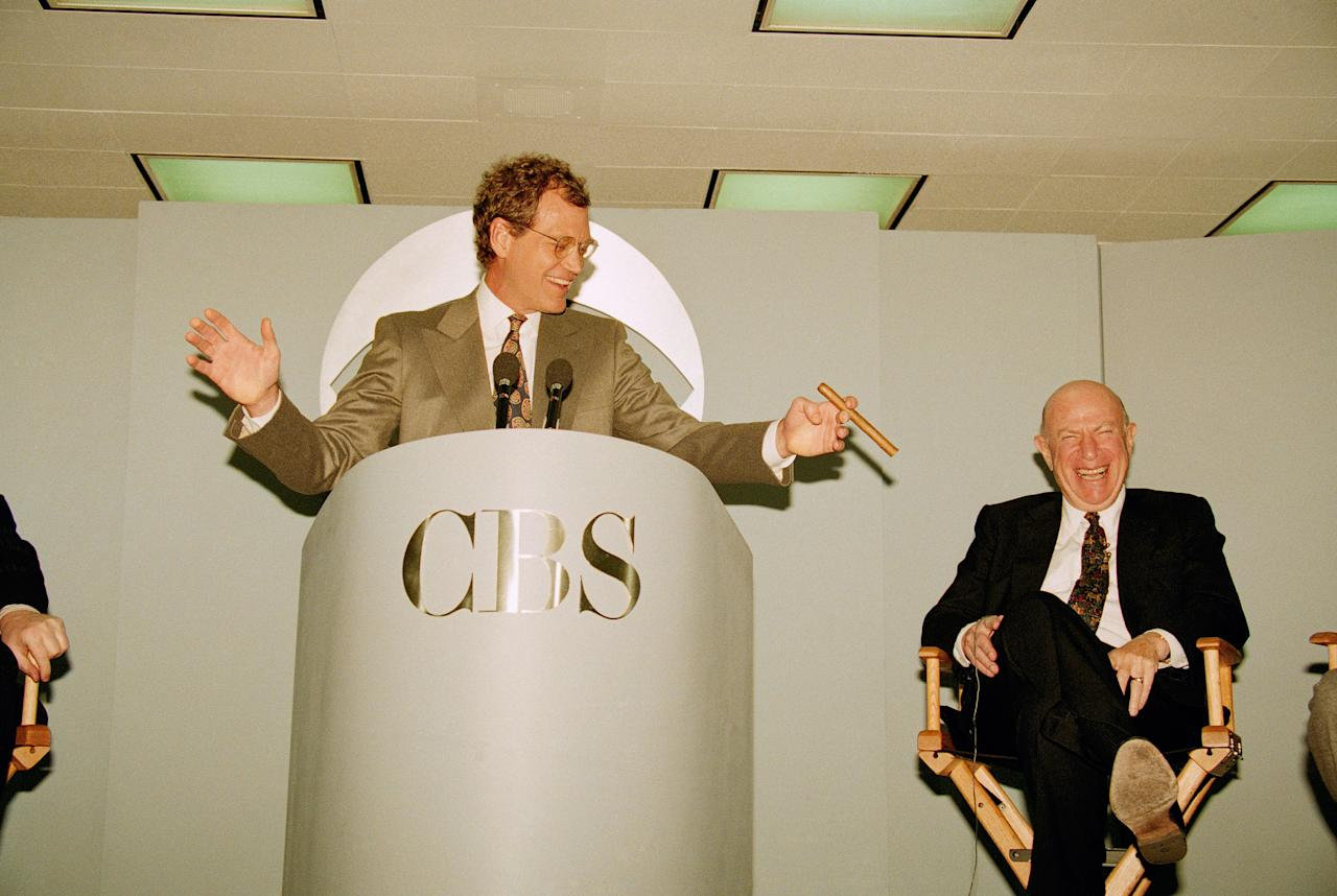 "With CBS president and CEO Laurence Tisch at his side, talk-show host David Letterman gestures as he tells of his move from NBC to CBS during a news conference in New York, Jan. 14, 1993. CBS announced that Letterman's show will run against NBC's ""The Tonight Show"" with Jay Leno. (AP Photo/Alex Brandon)"