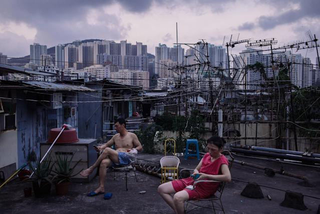Migrant workers take a break after dinner outsidea rooftop hut on June 3, 2017, in Hong Kong. Inequality has been on the rise for years, causing experts to worry about its destabilizing effects. (Billy H.C. Kwok via Getty Images)