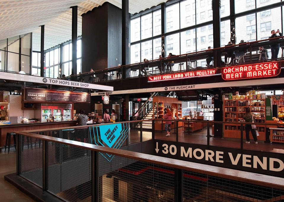 <p><strong>What's this place about?</strong> The new Essex Market is a far cry from the original, founded in 1888 with pushcart vendors. A mainstay of the Lower East Side since its opening, the market moved across into a sleek new space on Houston Street in late 2019. Mixing old-school green grocers and butchers with hip prepared-food stalls, the new iteration has the feel of a great European market hall.</p> <p><strong>What can we find here, or what should we look for?</strong> Upstairs, you'll find traditional purveyors like butchers, cheese makers, and vegetable and fruit stalls. Downstairs in the Market Line, there are prepared items from small business and New York food icons.</p> <p><strong>If money's no object, what goes in the cart?</strong> Stock your entire fridge and get enough to-go prepared food to have the global dinner party of your dreams. Arancini fresh from the fryer, currywurst from an old Upper East Side sausage shop, handmade tortillas straight from the press: The variety is almost endless and, with the space spanning more than three blocks, the choices are too.</p> <p><strong>And … what if we're on a budget?</strong> Essex Market used to be where you went for real-deal grocers. Now, it's the perfect spot for a date spot—come and share a few small plates.</p> <p><strong>Who else shops here?</strong> The new Essex Market draws a mix of families that have been living in the neighborhood for decades and hipsters stocking up before they head home to Brooklyn by way of the nearby Williamsburg Bridge.</p> <p><strong>Anything else we'll love?</strong> The space itself is memorable—you're simultaneously connected to the history of the market (street life is bustling around you) and aware that you're in a super-cool, new, underground space.</p>