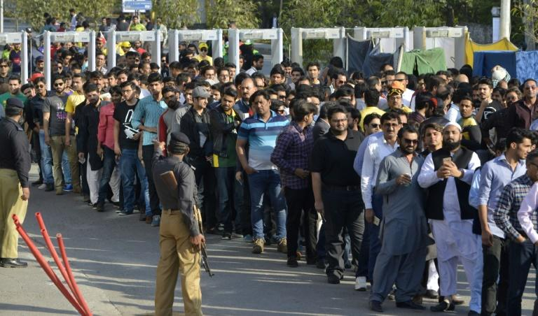 Pakistani spectators queue at one of entry gate of The Gaddafi Cricket Stadium in Lahore on March 5, 2017, as they arrive to watch the final cricket match of the Pakistan Super League (PSL) between Quetta Gladiators and Peshawar Zalmi