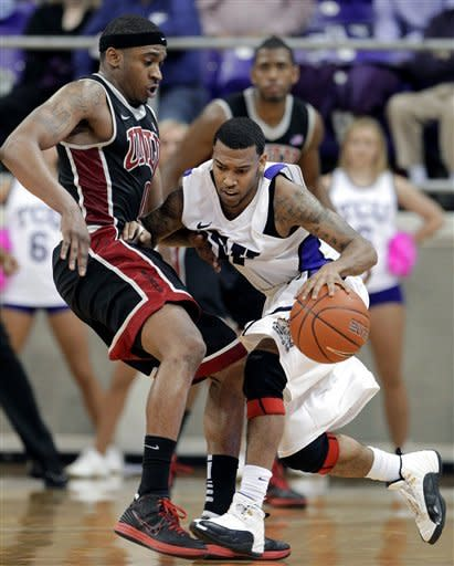 TCU's Hank Thorns, right, looks for room against UNLV 's Oscar Bellfield, left, in the second half of an NCAA college basketball game Tuesday, Feb. 14, 2012, in Fort Worth, Texas. Thorns led all scoring with 32 points in the 102-97 victory over UNLV. (AP Photo/Tony Gutierrez)