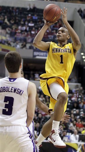 Minnesota guard Andre Hollins (1) goes up for a jump shot against Northwestern guard Dave Sobolewski in the overtime of an NCAA college basketball game at the first round of the Big Ten Conference tournament in Indianapolis, Thursday, March 8, 2012. Minnesota won 75-68 in overtime. (AP Photo/Michael Conroy)