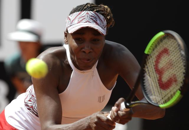 Venus Williams returns the ball to Estonia's Anett Kontaveit, at the Italian Open tennis tournament in Rome, Thursday, May 17, 2018 (AP Photo/Alessandra Tarantino)