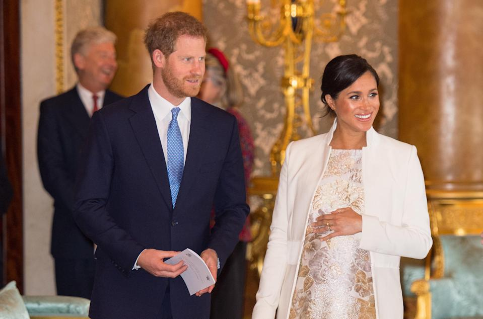 Harry and Meghan at a reception to celebrate Charles' 50th anniversary as Prince of Wales, in March 2019 [Photo: Getty]