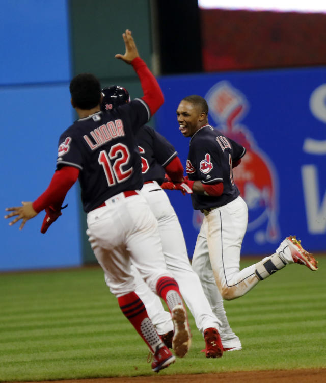 Cleveland Indians' Greg Allen, right, celebrates with teammate Yandy Diaz and Francisco Lindor (12) after his game winning single in the eleventh inning of a baseball game against the Boston Red Sox, Sunday, Sept. 23, 2018, in Cleveland. Cleveland won 4-3. (AP Photo/Tom E. Puskar)
