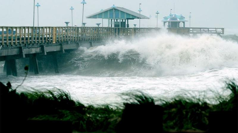 Eleven metre waves smashed the Miami foreshore. Source: Getty
