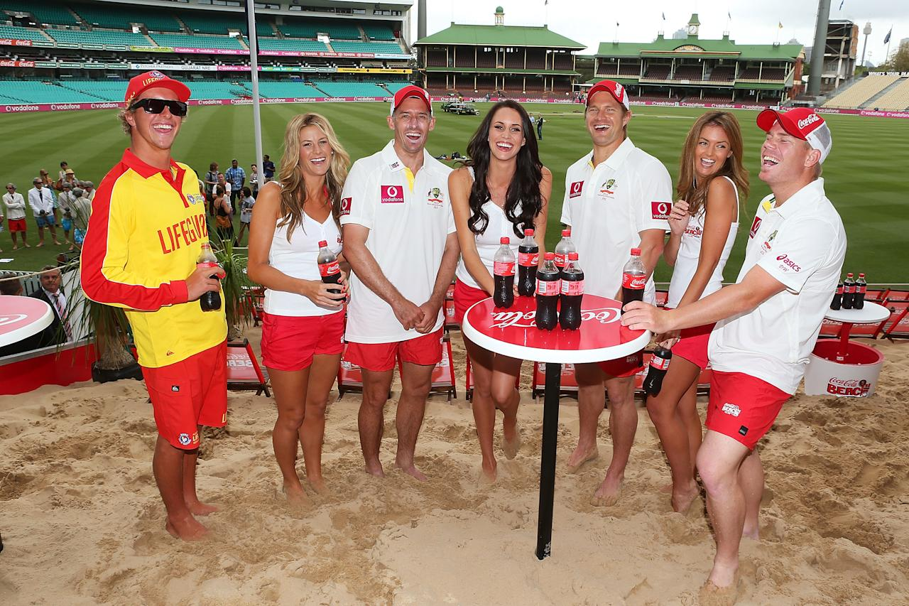 "SYDNEY, AUSTRALIA - JANUARY 02:  Shane Watson, David Warner and Michael Hussey of Australia pose with models during a ""COCA-COLA Beach at the Cricket"" event at Sydney Cricket Ground on January 2, 2013 in Sydney, Australia.  (Photo by Brendon Thorne/Getty Images)"