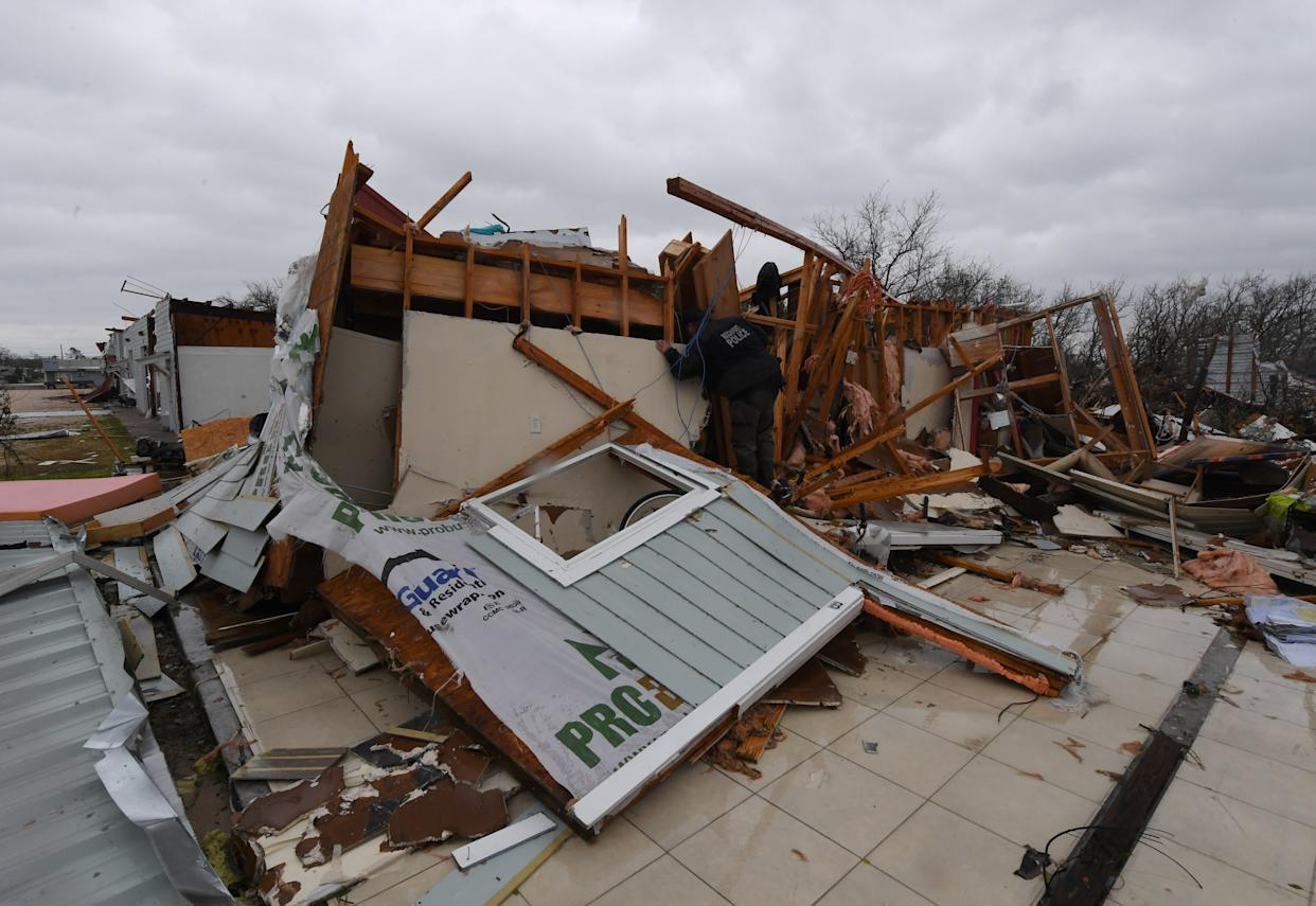 A police officer checks for survivors among destroyed houses in Rockport.