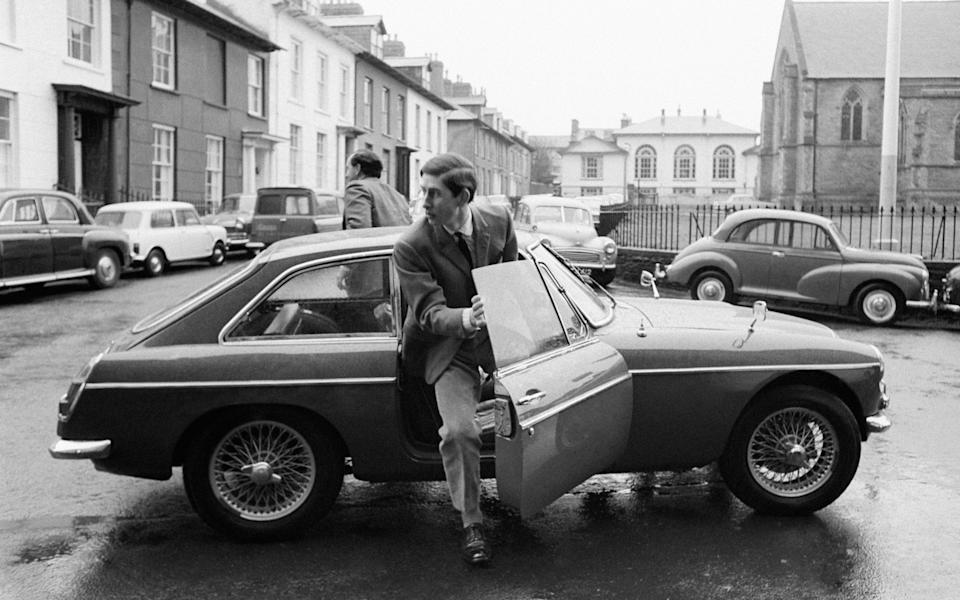 Prince of Wales steps out of his own blue MGC car after driving himself to the University College of Wales to begin his nine-week course. 21-04-1969 - PA
