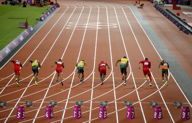 Jamaica's Usain Bolt, in lane 7, races at the men's 100m final during the London 2012 Olympic Games at the Olympic Stadium August 5, 2012. REUTERS/Paul Hanna (BRITAIN - Tags: SPORT ATHLETICS SPORT OLYMPICS)
