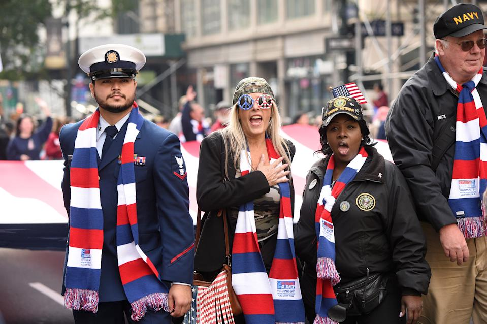 NEW YORK, NEW YORK - NOVEMBER 11:   People watch the Veterans Day Parade on November 11, 2019 in New York City. President Donald Trump, the first sitting U.S. president to attend New York's parade, offered a tribute to veterans ahead of the 100th annual parade which draws thousands of vets and spectators from around the country.  (Photo by Kevin Mazur/Getty Images)