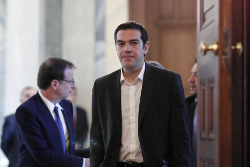 Leftist leader Alexis Tsipras , arrives at the Presidential Palace in Athens, Sun. May 13 2012. Greek President Karolos Papoulias has called the leaders of Greece's political parties to meetings on Sunday, in a last-ditch effort to broker a deal for a coalition government.(AP Photo/Kostas Tsironis)