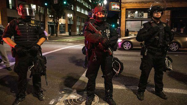 PHOTO: Police stand guard in Portland, Oregon, on Aug. 29, 2020. (Paula Bronstein/AP)