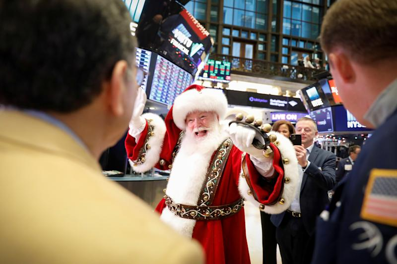 The Macy's Santa Claus waves to traders on the floor at the New York Stock Exchange (NYSE) in New York, U.S., November 27, 2019. REUTERS/Brendan McDermid