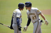 Milwaukee Brewers' Willy Adames, right, celebrates with teammate Eduardo Escobar (5) after hitting a home run off Atlanta Braves' Charlie Morton during the first inning of a baseball game Sunday, Aug. 1, 2021, in Atlanta. (AP Photo/Ben Margot)