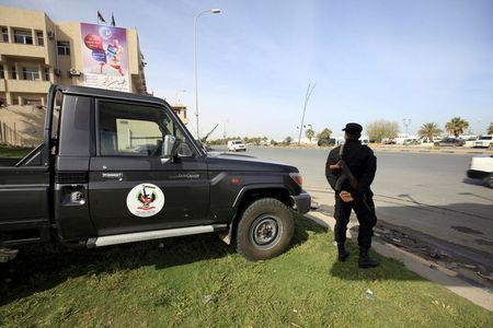A member of the force assigned to protect Libya's unity government stands on a road leading to where the government has their offices, in Tripoli, Libya March 31, 2016. REUTERS/Ismail Zitouny