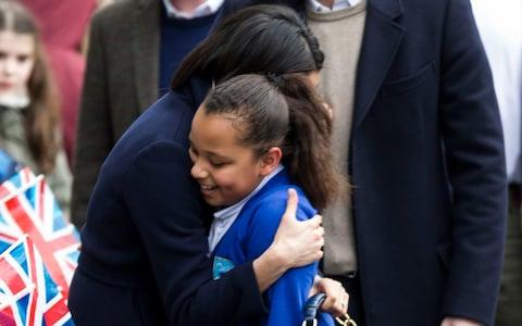 Meghan Markle hugs a schoolgirl in Birmingham - Credit: Heathcliff O'Malley for The Telegraph
